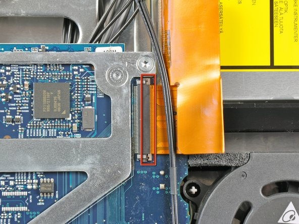 Gently pull the cable retainer on the optical drive cable ZIF socket toward the right side of the iMac.