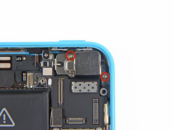 Remove the two 1.5 mm Phillips #000 screws securing the rear-facing camera to the rear case.