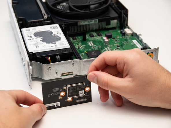 Carefully remove the WiFi Card from the metal chassis.