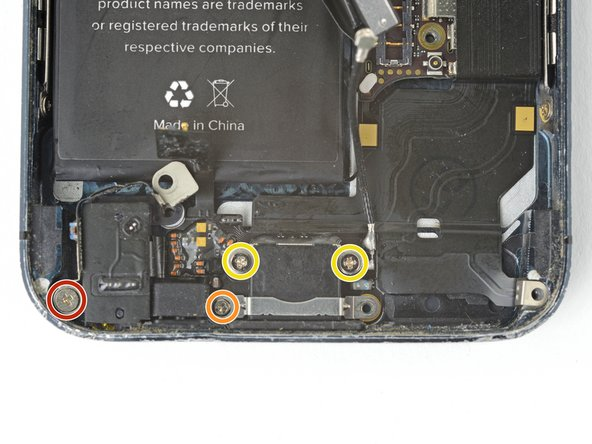 Remove the following screws securing the Lightning connector assembly to the rear case: