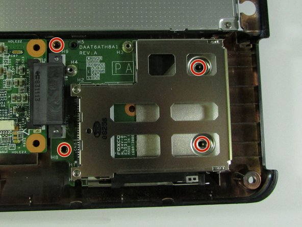 Remove screws from the ExpressCard component.