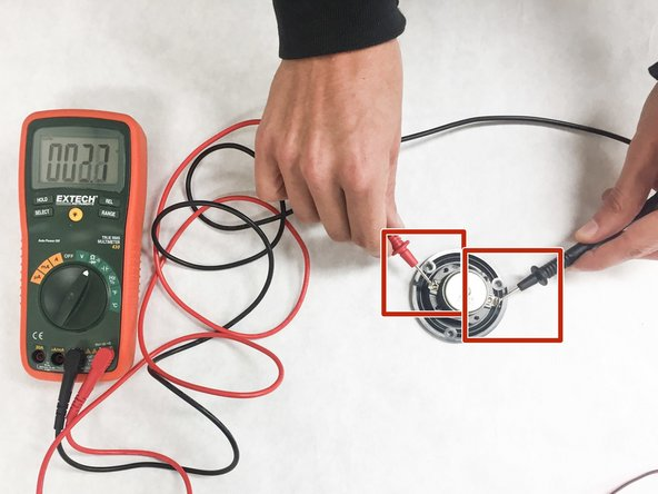 """Connect both ends of the speaker to the positive and negative leads of the multimeter. If there is an unbroken circuit through the speaker there will be a continuous tone output from the multimeter and/or the meter will not read """"OL"""" (open)."""