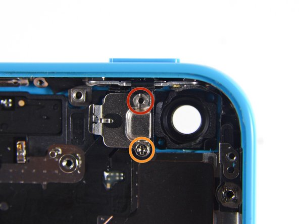 Remove the following screws securing the upper assembly contact bracket to the rear case: