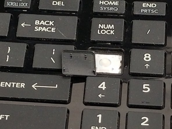 If there is any debris underneath key, first clean before replacing it.