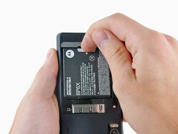 Lift the battery out of the Droid 2 from the edge closest to the bottom of the phone.