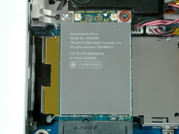 Remove the single black 4.3 mm T6 Torx screw from the top right corner of the AirPort Extreme card.