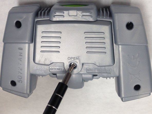 Remove the screw on  the battery lid. Using the Hex 4 socket and PH #0 bit, remove the 8 mm screw.