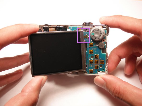 Verify that the LCD screen is attached to the chip on the back on the camera.