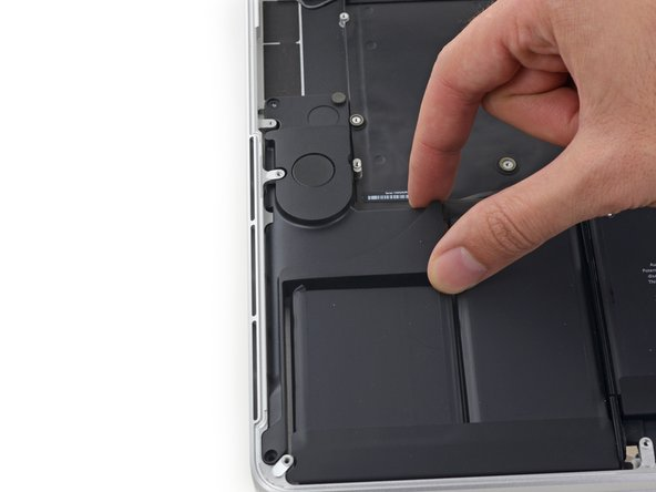 Remove the right speaker by pulling it slightly away from the side of the upper case, and out from under the aluminum tab blocking it in.
