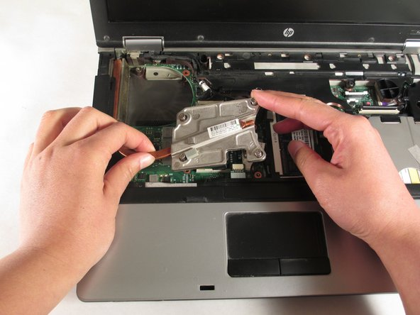 Reinsert the heat sink into the laptop. Tighten the screws to secure it into place.