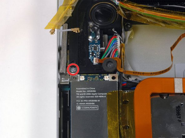 Remove the single silver Phillips screw located just above the Airport Extreme card.