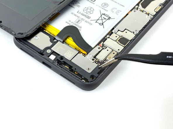Use a pair of tweezers to remove the battery connector shield.