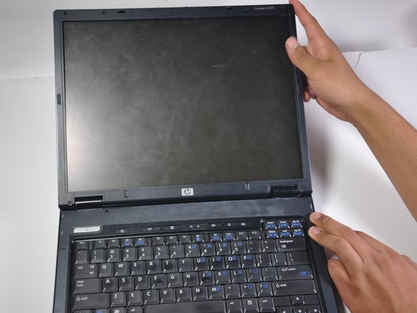 Open up the laptop so that the screen is facing towards you. Push the monitor back until it is flat, parallel to the keyboard.
