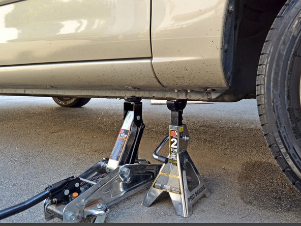 Place the jack back under the car's subframe and raise the car until the jack stand is no longer supporting it.