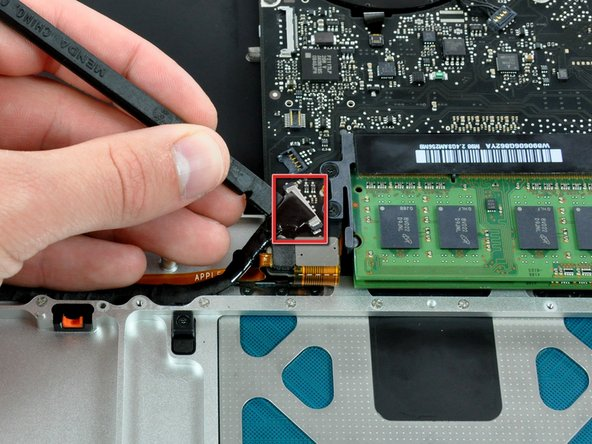 Use a spudger to pry the hard drive cable connector straight up off the logic board.