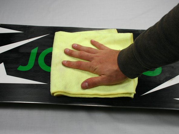 If the bottom of your board has dirt or oil on it, clean it off using a shop towel and a citrus based cleaner.