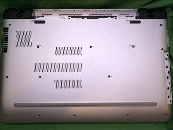 When reassembling, keep the unit upside down and slide the bottom cover back into place hinges first.