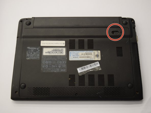 Locate the circular slot positioned at the bottom right of the battery.
