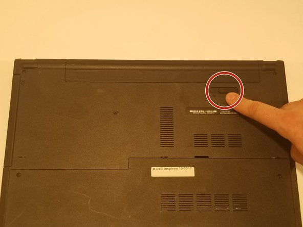 Locate the battery release switch on the bottom of the laptop.
