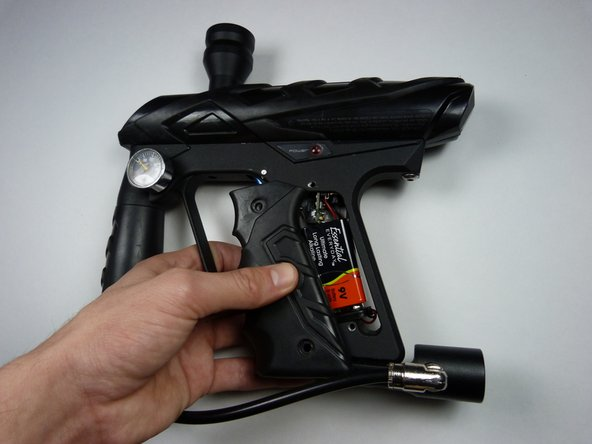 Remove the grip by sliding it towards the front of the gun.