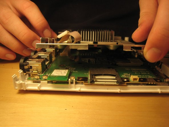 Once all screws are removed, lift off the logic board cover.