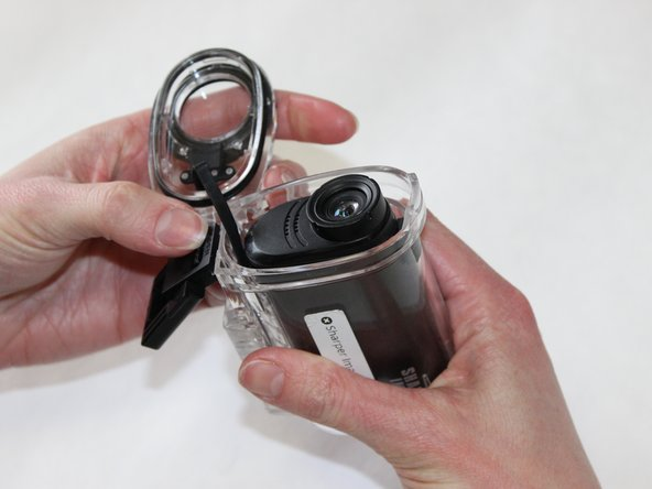 Once the latch is free, simply pull the front of the waterproof case off and slide the camera out.