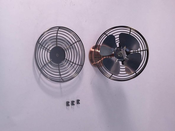 The Guard of the fan is detached from its base due to the effectiveness of  a screwdriver.