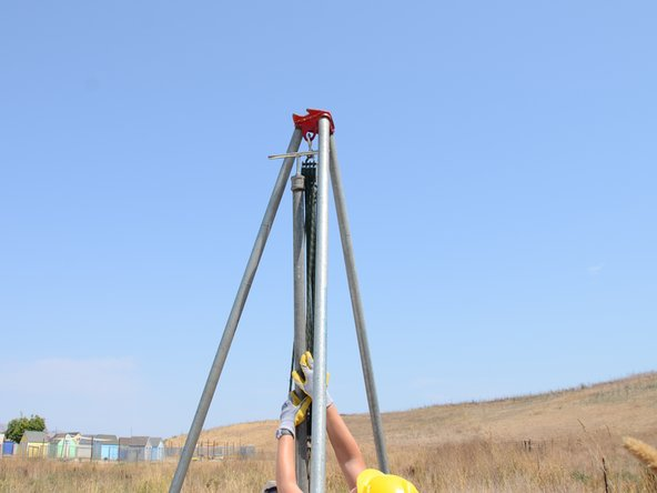 The tripod has an indentation built into its top to guide the riser pipe.
