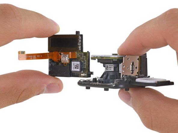 With a flick of the wrist goes the display and the power/capture button—everything a user needs to operate the GoPro on one confusing bracket.