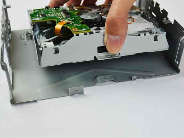 Lift the DVD-Drive to separate it from the metal case.
