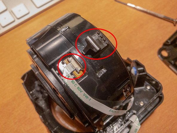 Remove the black plastic clip covering the flat cable's connection. Distance the brown coloured retaining mechanism from its base at the entry of the flat cable. The cable will become lose and you can easily remove it.