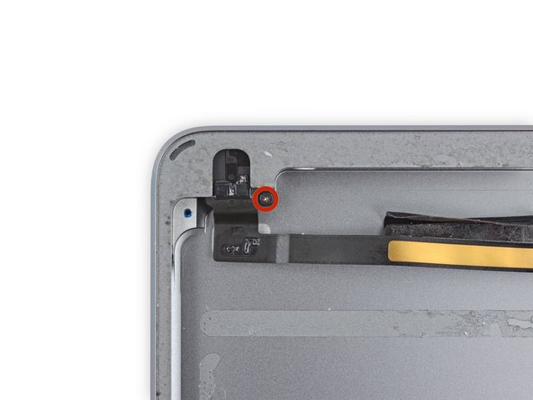 Remove the single 4.3 mm Phillips #000 screw from the headphone jack.