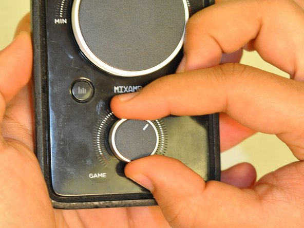 Grip the dial tightly and pull straight off the device.
