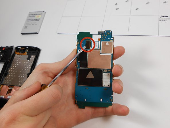 To remove damaged camera flip hardware so the lens of the camera is facing downwards and remove ribbon cable connecting camera to hardware.