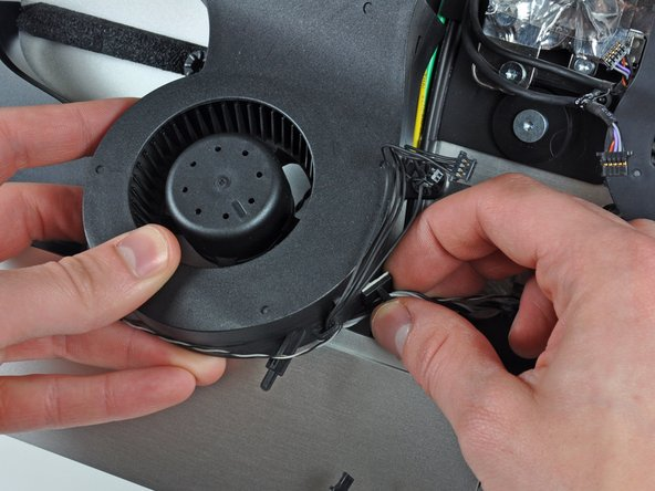 Peel the cable retainer off the side of the CPU fan.