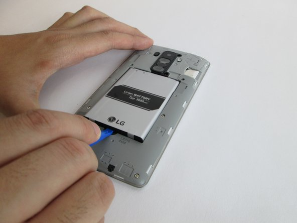 Insert the plastic opening tool into the indent at the bottom of the battery and lift up. Fully remove the battery with your fingers.