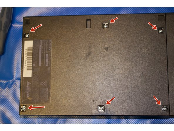 Remove the six screw covers and place on project mat.