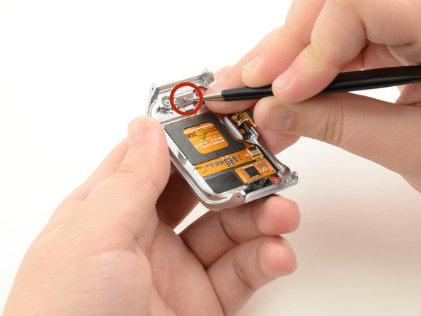 Use either the tweezers or the spudger to push the button peg out through the hole.