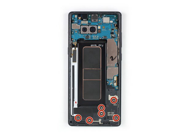 Remove the six Phillips #00 screws on the loudspeaker assembly at the bottom of the phone.