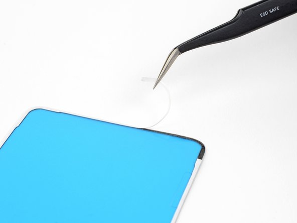 Peel away the white backing, exposing one side of the adhesive strip.
