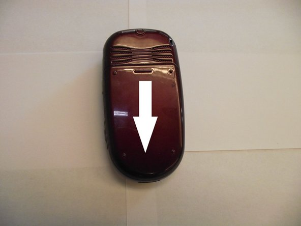 Using your thumb, slide battery cover off in a downward direction.