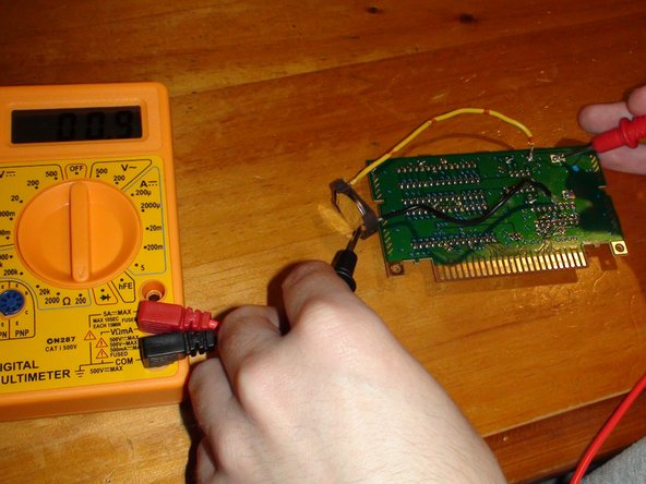 Now to test that you've made a good connection with the solder. Set your Multimeter to 200 Ohms and test the connection between the main battery terminals and the parity battery. For visual reference, do as shown in the two images on this step.