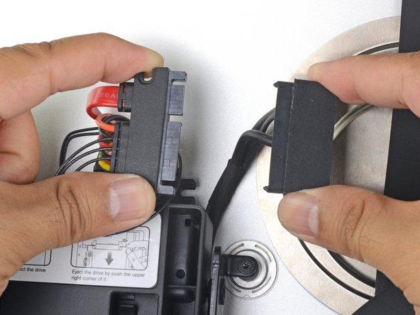 Attach the iMac's SATA-combo cable to the new temperature-capable SATA-combo cable.