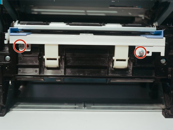 Remove 2 screws to remove the paper feed bar.