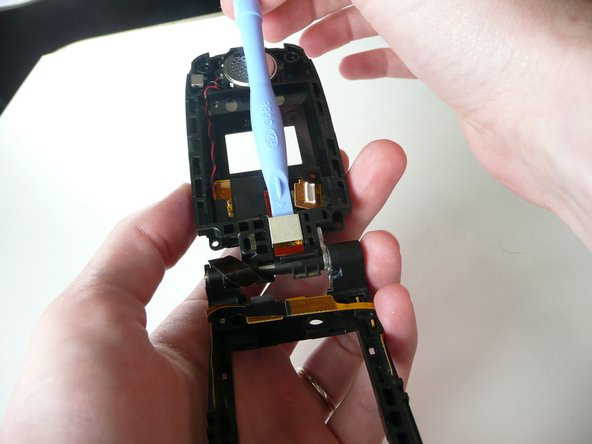 Use iPod opening device to remove the metal cover.