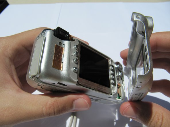 Carefully remove the rear camera casing.