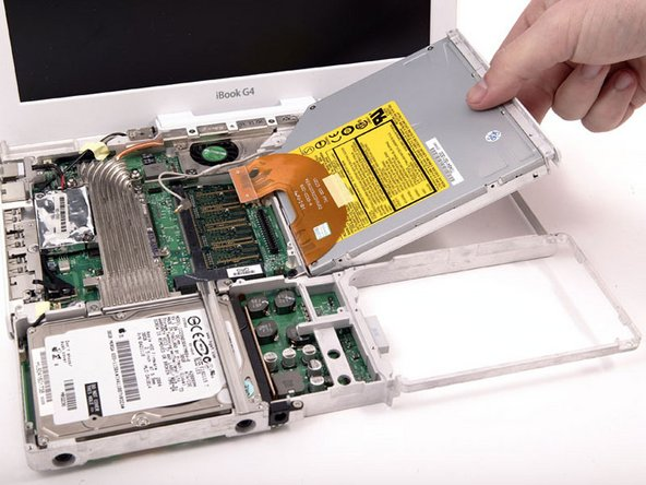 Lift the optical drive from the metal framework.