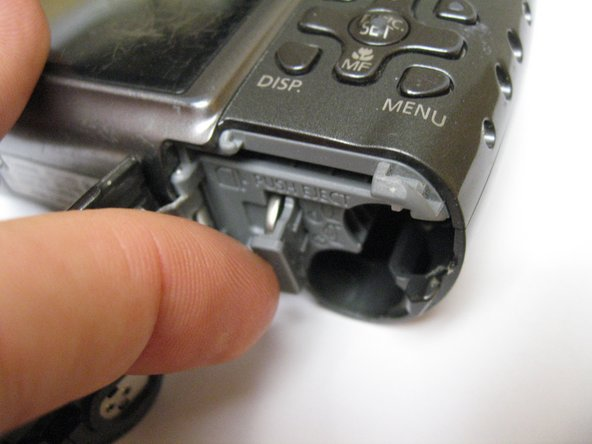 When accessing the clock battery, use a fingernail or similar small instrument to gently pull the tab out.