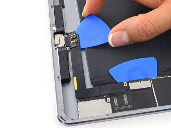 The Lightning connector cable is stuck to the case with some adhesive. To detach the adhesive you will be sliding an opening pick between the cable and the case. Be very careful not to cut the Lightning connector cable itself.