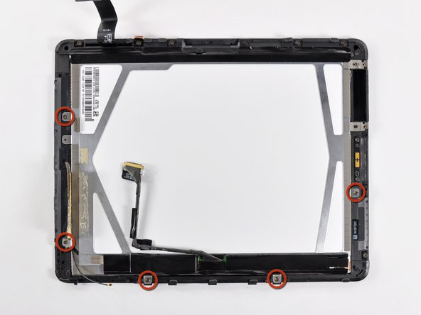 Remove the remaining T5 Torx screws securing the LCD to the black plastic display frame.